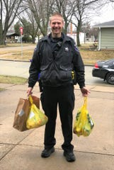 Sgt. Matt Kuether delivers groceries as part of the Appleton Police Department's Good Neighbor Program. Officers typically don't run errands, but in this case Kuether picked up an online order for a widow.
