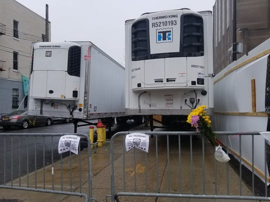 Freezer trucks are stationed as a makeshift morgue outside a New York hospital.