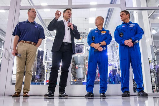 SpaceX founder Elon Musk (2nd L) addresses the media alongside NASA Administrator Jim Bridenstine (L), and astronauts Doug Hurley (2nd R) and Bob Behnken (R), during a press conference announcing new developments of the Crew Dragon reusable spacecraft, at SpaceX headquarters in Hawthorne, California on October 10, 2019. (Photo by Philip Pacheco / AFP) (Photo by PHILIP PACHECO/AFP via Getty Images)
