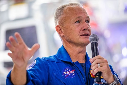 NASA astronaut Doug Hurley, an Apalachin, NY native, addresses the media during a press conference announcing new developments of the Crew Dragon reusable spacecraft in October 2019.