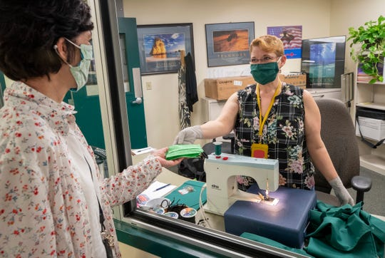 Wendy Wreyford, an office administrator at the Puget Sound Naval Shipyard, thought she'd be using fabric for curtains in her office. But when the pandemic came, she brought her sewing machine to work and started making cloth masks.