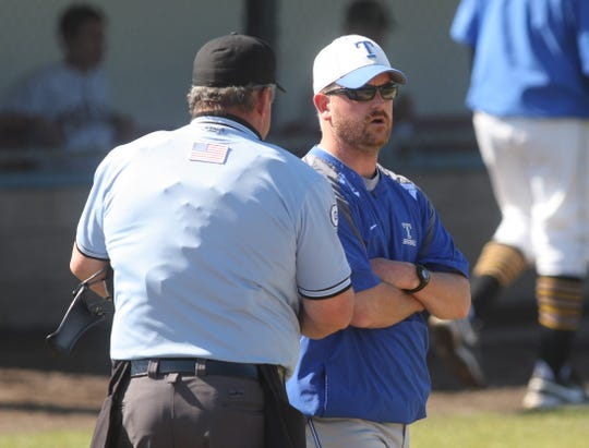 Olympic High School athletic director Nate Andrews formerly coached the Trojans' baseball team. He grew up playing baseball at Burlington-Edison High School.