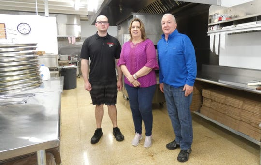 Owners Billy Gleason, Kristina Nelson and Roger Nelson stand in the kitchen at Gionino's Pizzeria on South Lane Street on Tuesday, the first day of business.