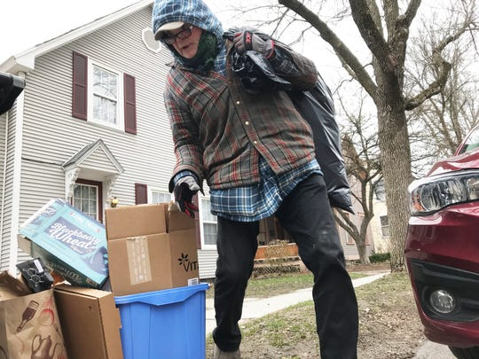 Lionel Persinger, 62, of Burlington, gathers recyclable cans and bottles on South Winooski Avenue on April 22, 2020. Persinger says he is not perturbed by the spread of COVID-19 — and has seen a significant hike in hard liquor consumption by city residents.