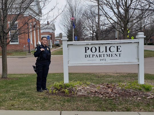 "Williston Police Officer Sarah Bell stands outside the town police department in this undated photo. Bell said that she had to get tested after believing she was exposed to COVID-19 on the job. While awaiting her results, she and her significant other - also a police officer - lived in separate areas of their house. ""You definitely think about how quickly this can spread and how many people you interacted with and the importance of wearing a mask and keeping your distance,"" Bell said. ""It really brings it all home for you."""
