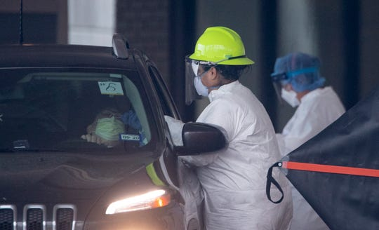 Heath care workers conduct COVID-19 testing at the Corpus Christi's drive-thru testing center at the old Christus Spohn Memorial Hospital parking lot on Thursday, April 23, 2020.