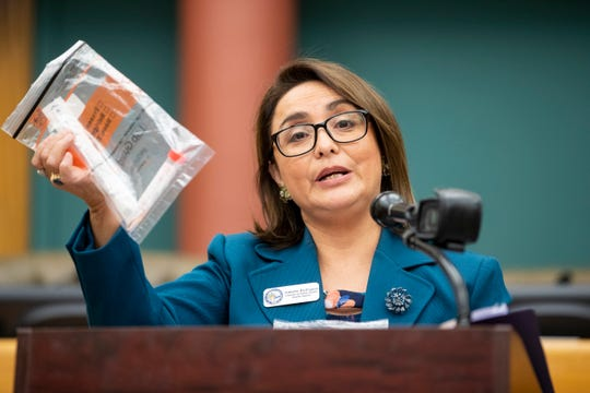 Annette Rodriguez, Director of Public Health for the Corpus Christi-Nueces County Public Health District holds up a COVID-19 test kit during the daily press conference at city hall on Tuesday, April 21, 2020.