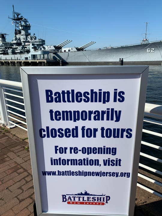 The retired battleship New Jersey, BB-62, sits closed to the public as a floating museum on the Delaware River in Camden under orders by New Jersey Gov. Phil Murphy to help prevent the spread of the highly contagious coronavirus pandemic. Murphy's state of emergency calls for closure of all nonessential businesses and for the public to stay at home to prevent gatherings of people and promote social distancing.