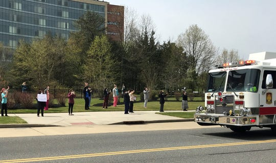 Staffers at Virtua Voorhees Hospital on Wednesday wave to participants in a thank-you parade organized by area police, firefighters and first responders.