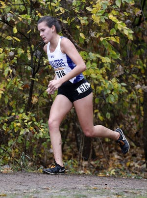 Chillicothe's Caitlyn Mauger runs in the Division I Regional Cross Country meet at Pickerington North High School. Mauger will attend and run tranck and cross country at Heidelberg University.