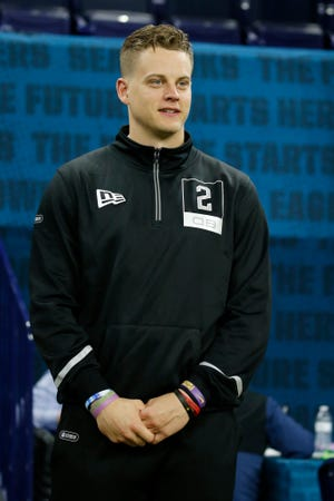 Feb 27, 2020; Indianapolis, Indiana, USA; Louisiana State Tigers quarterback Joe Burrow (QB02) watches the workouts on the field during the 2020 NFL Combine at Lucas Oil Stadium.