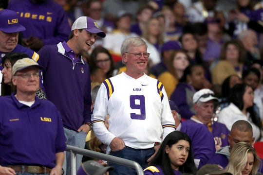 Dec 28, 2019; Atlanta, Georgia, USA; Jimmy Burrow talks with a fan before the 2019 Peach Bowl against the Oklahoma Sooners and the LSU Tigers at Mercedes-Benz Stadium. Burrow is the father of LSU quarterback Joe Burrow.