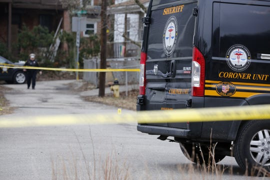 A Hamilton County coroner's van arrives at the scene of a suspicious death in January.