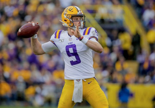 Oct 26, 2019; Baton Rouge, LA, USA; LSU Tigers quarterback Joe Burrow (9) throws against the Auburn Tigers during the first half at Tiger Stadium.