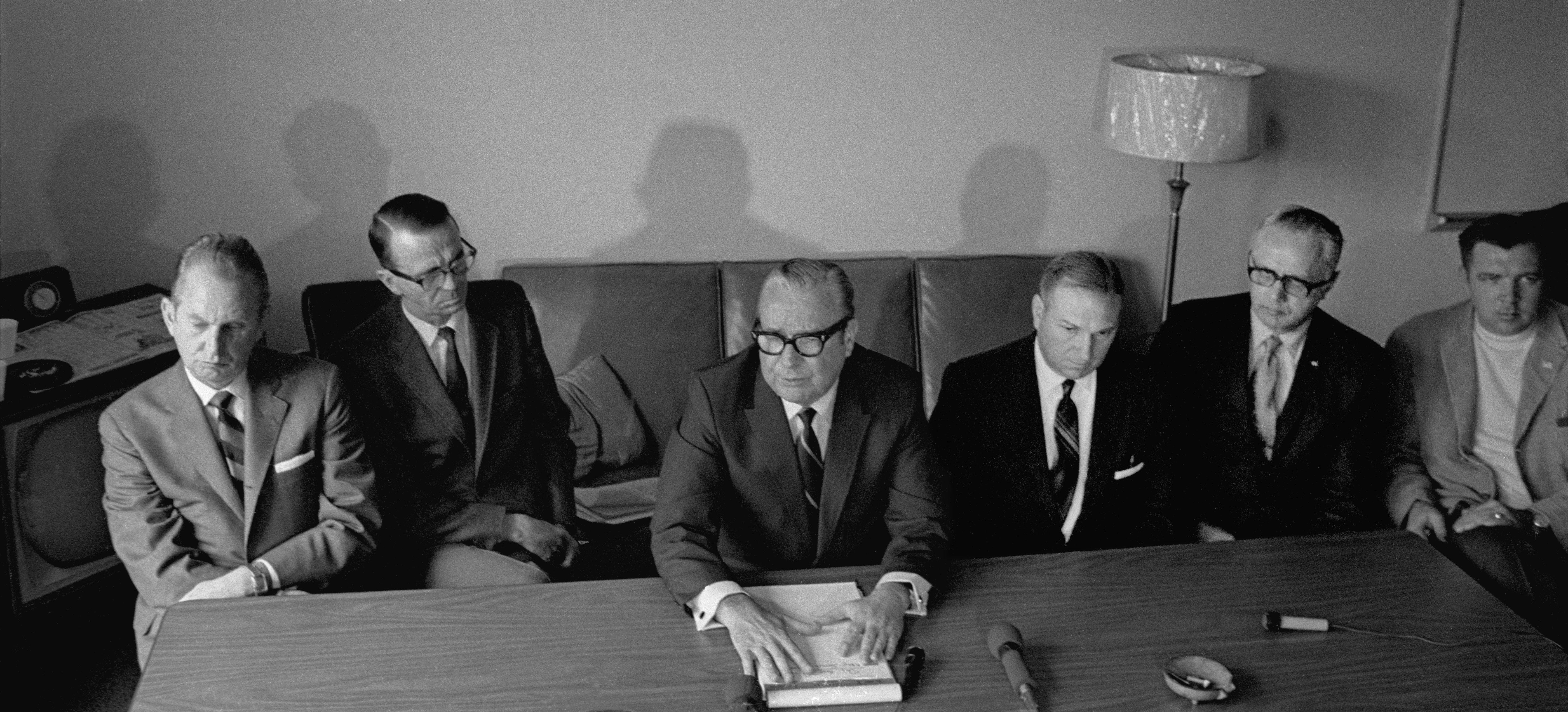 Ohio Gov. James Rhodes, at center with papers in his hands, holds a press conference at Kent State University on May 3, 1970, the morning after the ROTC building on campus was burned.  To the left of Rhodes is LeRoy Satrom, the Kent mayor who requested the National Guard. To the right is Maj. Gen. Sylvester T. Del Corso, the adjutant general who headed the Ohio National Guard units on campus on May 4, 1970.