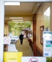 Montgomery County Mayor Durrett walks down the hall to a conference room where he and the Clarksville Mayor Joe Pitts will address citizens on reopening procedures at the William O. Beach Civic Hall in Clarksville, Tenn., on Thursday, April 23, 2020.