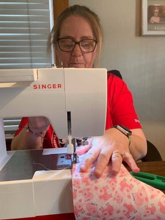 Susie Ristau has sewn scores of masks to help slow the spread of coronavirus to honor her son, Michael, an Army veteran who was killed in Afghanistan.