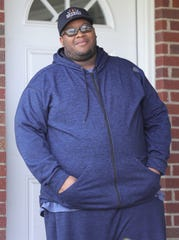Detroit Fire inspector Najuma Fulton is in quarantine at his home Monday in Warren.