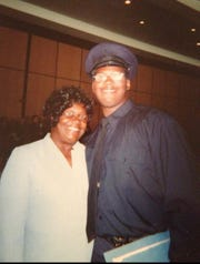 Fireman Najuma Fulton and his mother, Josephine Sampson, at his fire department graduation ceremony in 2000.