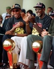 Bulls' Scottie Pippen, left, and Michael Jordan enjoy the team's NBA championship celebration in Chicago's Grant Park, June 16, 1997. The Bulls beat the Utah Jazz 4-2 in the best-of-7 NBA Finals.