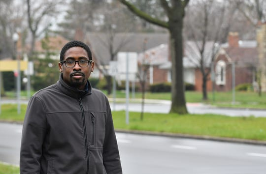 Karlton Akins, 40, president of the Bagley Community Council, stands near his home on W. Outer Drive in Detroit on April 23, 2020.