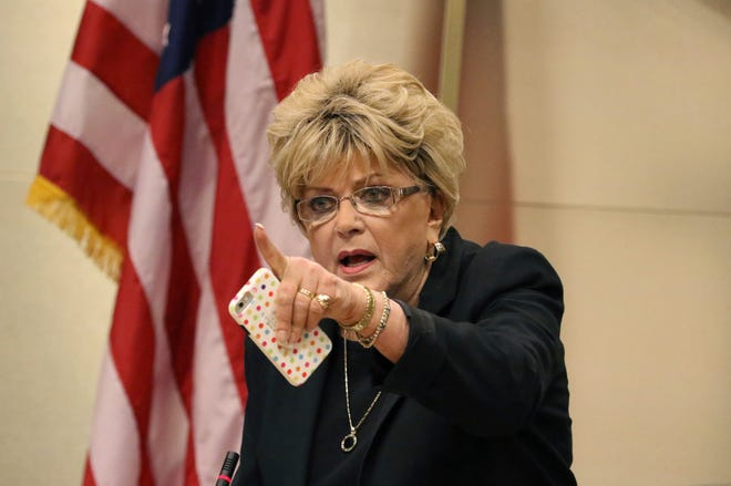 FILE - In this Nov. 6, 2019 file photo Las Vegas Mayor Carolyn Goodman points toward protesters during the council meeting where the city council was considering a ban on homeless camping in Las Vegas.