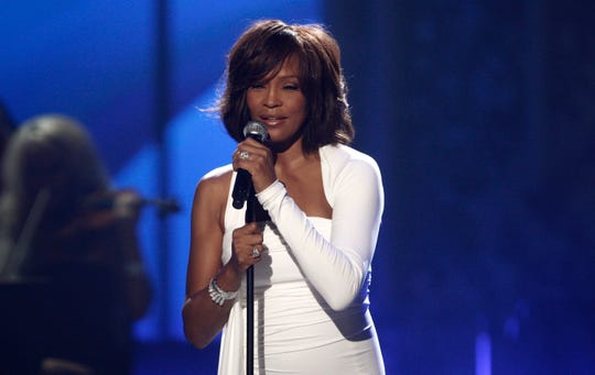 In this Nov. 22, 2009 file photo, Whitney Houston performs at the 37th Annual American Music Awards in Los Angeles.