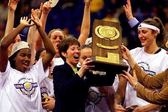 Muffet McGraw, center, abruptly retired Wednesday, stepping down from Notre Dame after a Hall of Fame coaching career that includes two national championships in 33 seasons.