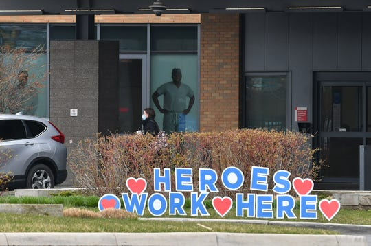 """""""Heroes Work Here"""" is posted outside Sinai-Grace Hospital in Detroit on April 23, 2020."""