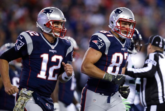 Tight end Rob Gronkowski, right, and quarterback Tom Brady spent nine seasons together in New England.