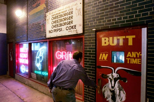 A customer enters the Billy Goat Tavern under Chicago's Michigan Ave. on Sept. 23, 2005.