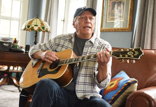 Devin Scillian sings and plays his guitar inside his home, Thursday, April 23, 2020. The WDIV anchor is performing daily songs on his Instagram page from inside his Grosse Pointe Park home.