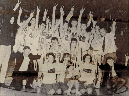 The 1968-69 Otwell basketball team celebrates the sectional title.