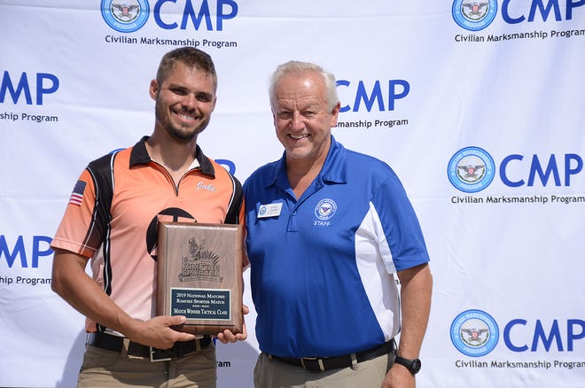 Jake Perry, left, receives TU-Class first place plaque from Steve Cooper, general manager of Civil Marksmanship Program, in August 2019 during the annual national matches at Camp Perry.