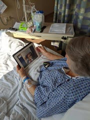 Lee Health patient Etna Wheeler uses an iPad to visit virtually with relatives in Fort Myers on Friday, April 17, 2020. Lee Health Foundation provided 30 donated iPads for patients who are not allowed to have visitors under pandemic restrictions. Hospital patients near death are allowed to have one visitor.