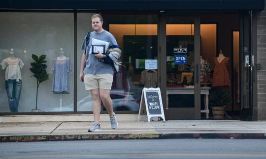 Nathan Morton, owner of White Willow Clothing, walks out of his store near the front entrance of the Anderson Mall in Anderson,  S.C. on Thursday, April 23, 2020. Morton said  he opened Tuesday, April 21 after abiding by the South  Carolina Gov. Henry McMaster executive order to reopen retail stores. The mall plans to open Friday, April 24, 2020, with reduced hours of 11 a.m. to 7 p.m. Monday through Saturday, and noon to 6 p.m. Sunday.  Gov. Henry McMaster issued an executive order reopening retail stores that were closed due to coronavirus, with strict social distancing requirements of 20 percent capacity and following relevant CDC and DHEC guidelines.
