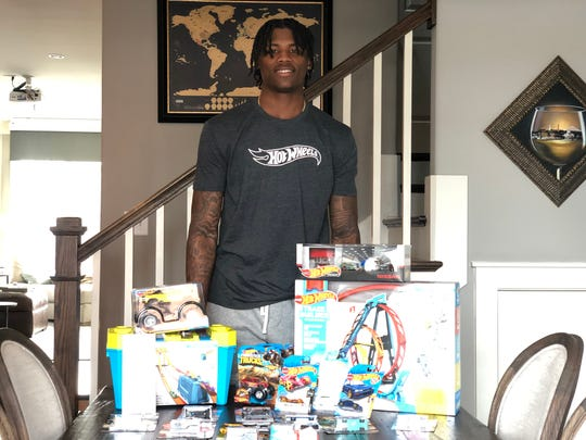 Former Clemson football standout and Hot Wheels aaficionado Tee Higgins with some of his donations.
