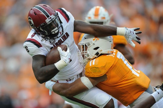 Oct 26, 2019; Knoxville, TN, USA; South Carolina Gamecocks running back Tavien Feaster (4) is tackled by Tennessee Volunteers linebacker Henry To'o To'o (11) during the first half at Neyland Stadium. Mandatory Credit: Randy Sartin-USA TODAY Sports