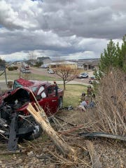 Crews from Great Falls Fire Rescue work at the scene of a vehicle versus home crash Thursday on Skyline Drive Northeast.