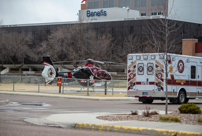 Mercy Flight helicopter sits parked on the landing pad outside of the Benefis Hospital emergency department in 2020.