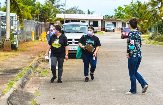 Nurses with the Department of Public Health and Social Services and the Guam Department of Education conduct a door-to-door canvass outreach in Astumbo, Dededo, Thursday, April 23, 2020. They went door-to-door to ask individuals of their present health status, as well as that of other occupants and informed the occupants of COVID-19 testing planned to be held at the Astumbo Gym on Saturday, April 25.