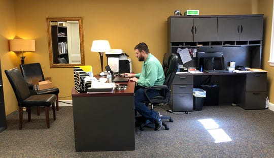 New Henderson Audubon Board of Realtors Association Executive Bryan Russelburg's office allows a visitor to sit six feet away, but most of his interactions with his members and others are conducted through web conferencing.