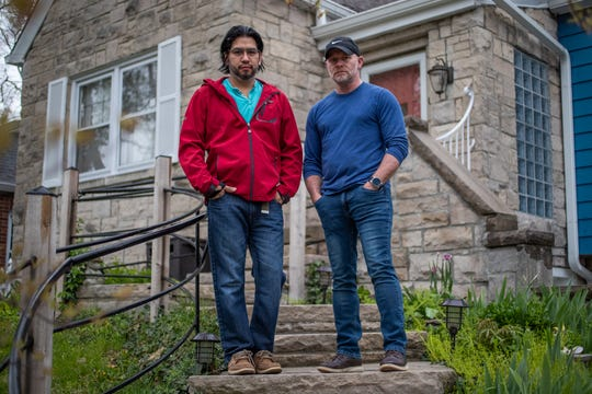 Harlon Wilson (right) and Enrique Gonzalez-Ortiz, who are denied the coronavirus stimulus package funds because Gonzalez-Ortiz is an immigrant and they filed a joint tax return, pose for a portrait on the steps of their Indianapolis home on Thursday, April 23, 2020. Gonzalez-Ortiz has been paying taxes since he came to the U.S. in 2005.
