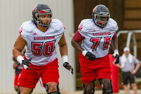 Shown together in the summer of 2018, UL offensive linemen Robert Hunt (left) and Kevin Dotson (right) are highly regarded 2020 NFL Draft prospects.