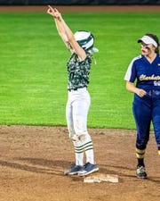 Howell's Skye Grant celebrates her go-ahead double in the seventh inning of a 9-6 victory over Clarkston in the state Division 1 softball semifinals on Thursday, June 13, 2019.