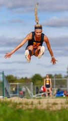 Hartland's Lindsey Strutz has cleared 17 feet, 1.25 inches in the long jump.