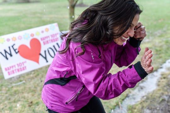 Traci Ruiz talks with Eva Salinas though a window on Eva's 101st birthday on Thursday, April 23, 2020, at the Ingham County Medical Care Facility in Okemos. Ruiz organized the birthday celebration for Salinas to enjoy from a window due to coronavirus restrictions.