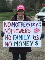Patricia Stephanoff was one of about five dozen people protesting Gov. Gretchen Whitmer's stay home, stay safe order April 23, 2020.