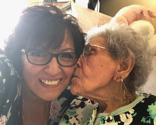 Eva Salinas kisses Mary Berneske's cheek in this undated photo.