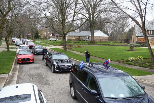 A caravan of protesters drive near the Michigan governor's mansion in Lansing, Thursday afternoon, April 23, 2020.  They were rallying against Gov. Gretchen Whitmer's stay-at-home order enacted to help mitigate the spread of COVID-19.
